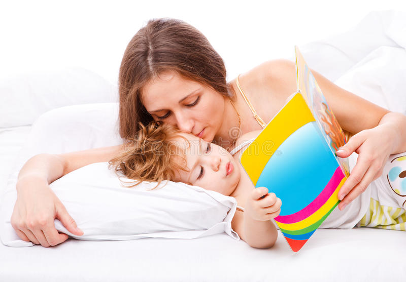 Download Mom kissing toddler stock photo. Image of lifestyle, laying - 13975270