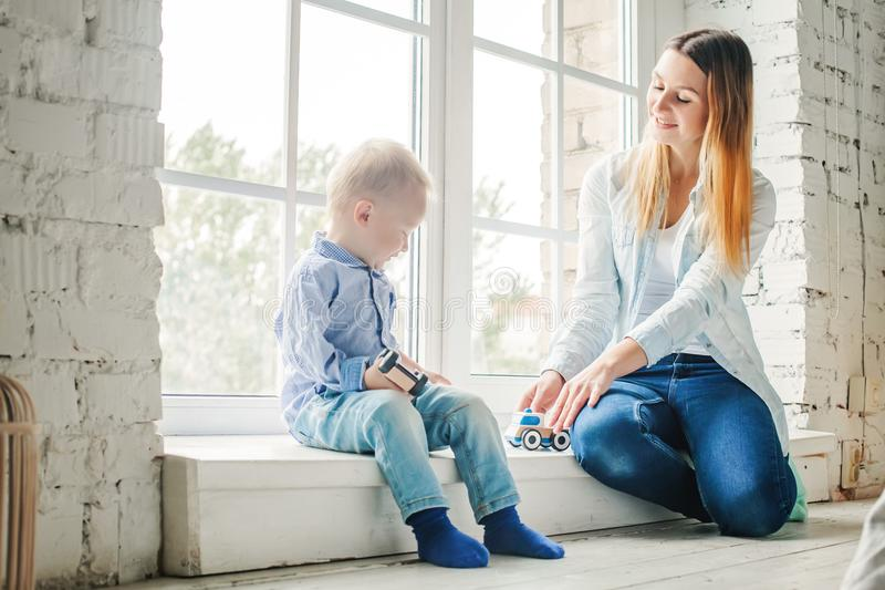 Mom and Little Child Boy Playing with Toys royalty free stock photo