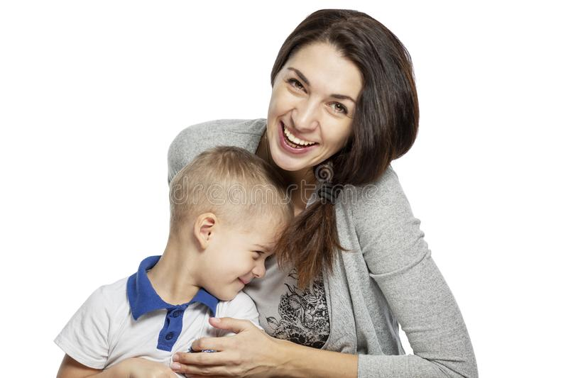 Mom and little son hug and laugh. Tenderness and love. Isolated on a white background. Copy space stock photos