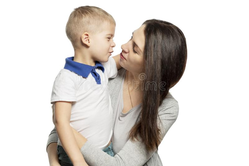 Mom and little son hug and laugh. Tenderness and love. Isolated on a white background. Horizontal royalty free stock photo