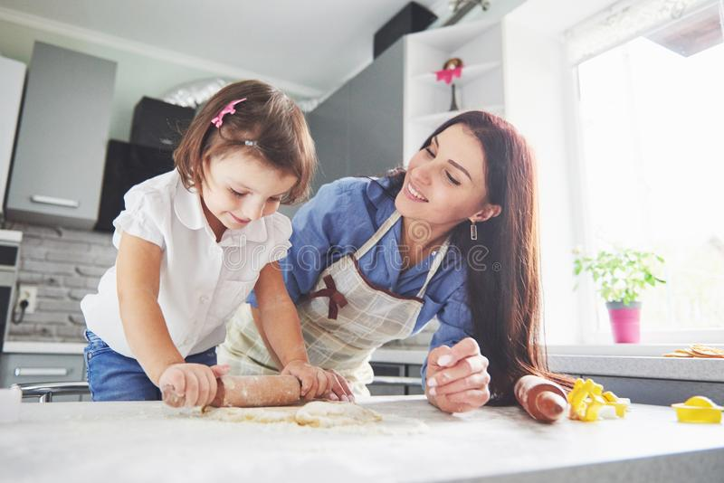 Mom loving the oven for the daughter of the cookie. stock photo