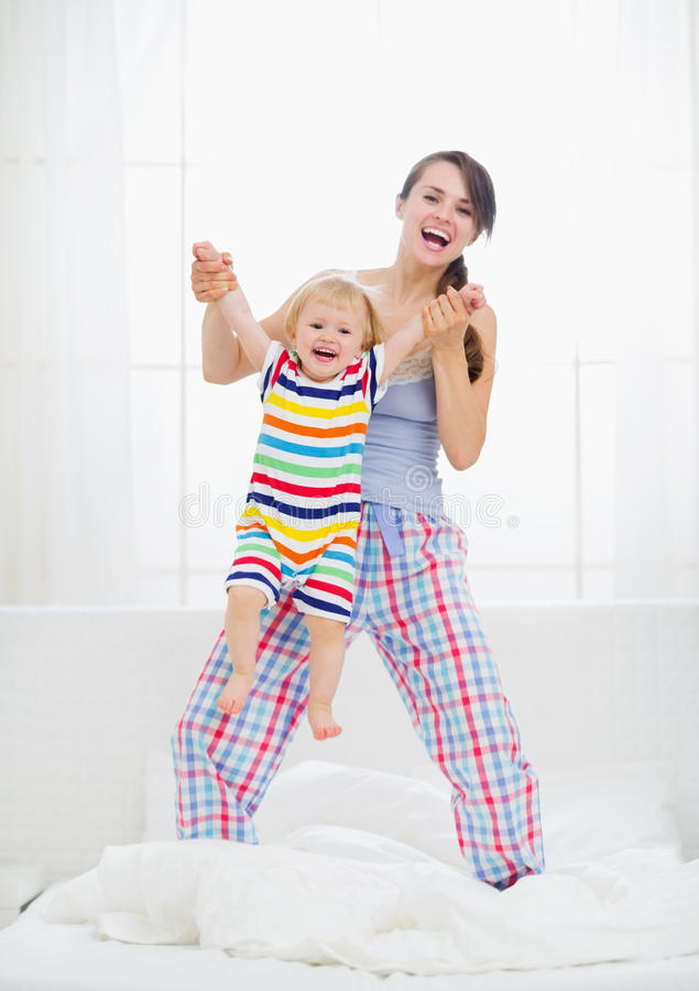 Download Mom Playing With Baby In Bedroom Stock Photography - Image: 25313962