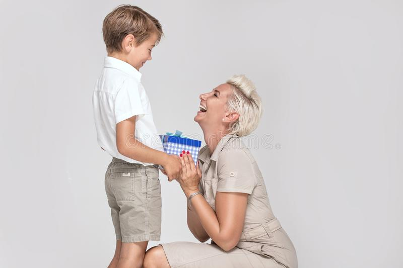 Mom posing with young son, smiling. royalty free stock photography