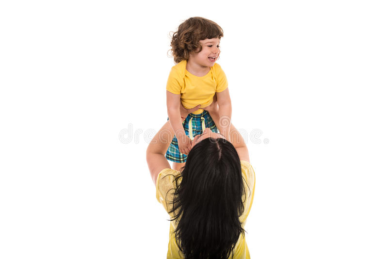 Mom raise child over head stock photos