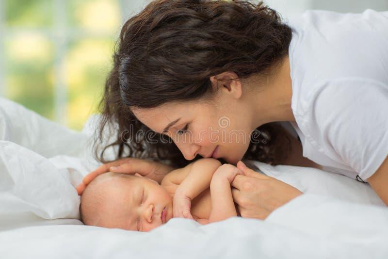 Mom`s love newborn. stock photography