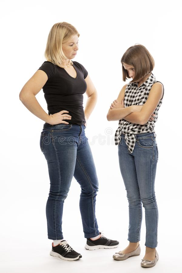 Mom scolds teen daughter, screaming stock image