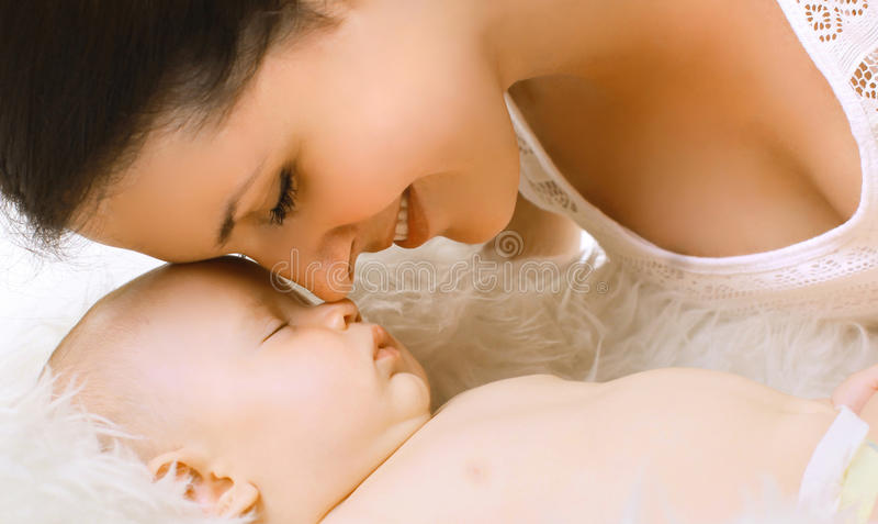 Mom and sleep baby stock image
