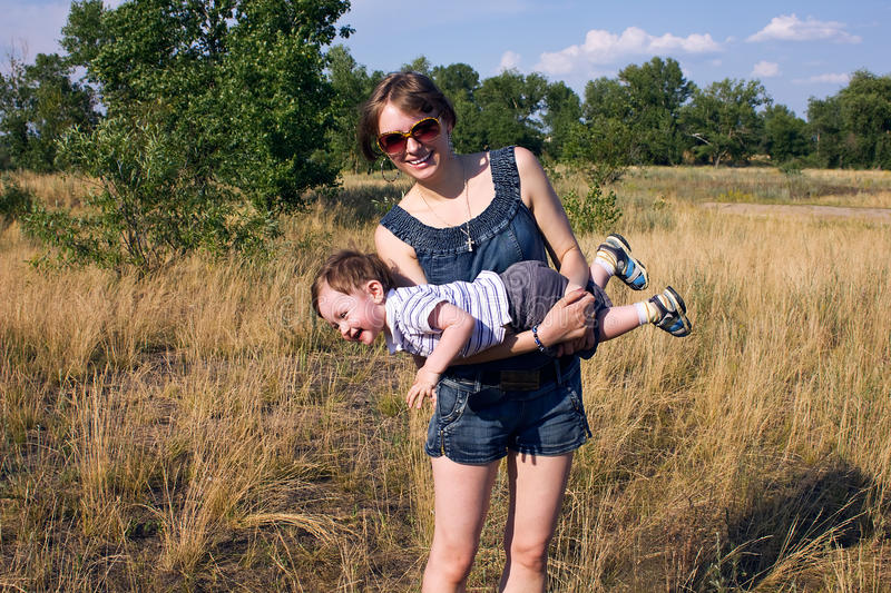 Download Mom and son stock image. Image of meadow, bright, view - 20015779