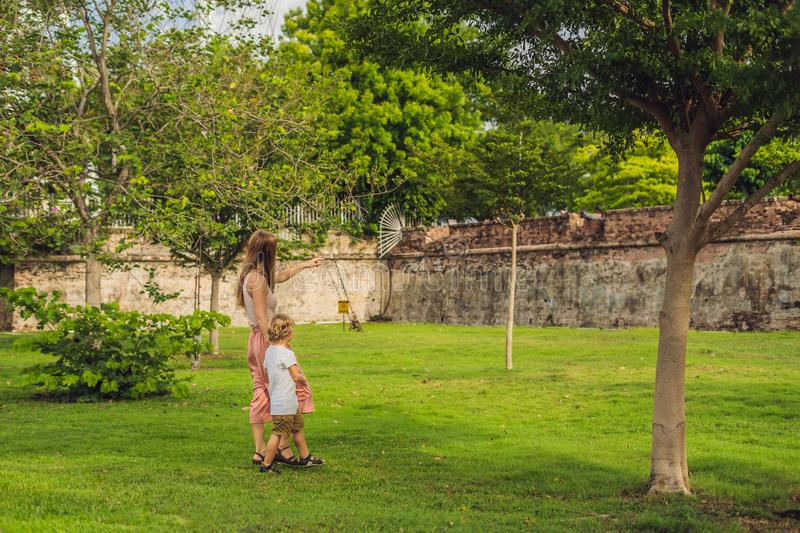 Mom and son on background of Fort Cornwallis in Georgetown, Pena. Ng, is a star fort built by the British East India Company in the late 18th century, it is the royalty free stock photos