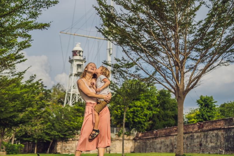 Mom and son on background of Fort Cornwallis in Georgetown, Pena. Ng, is a star fort built by the British East India Company in the late 18th century, it is the stock photos