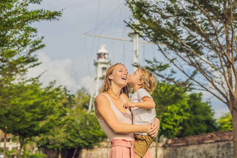 Mom and son on background of Fort Cornwallis in Georgetown, Pena. Ng, is a star fort built by the British East India Company in the late 18th century, it is the royalty free stock image