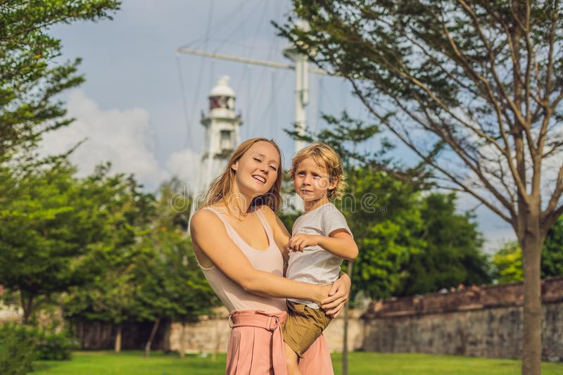 Mom and son on background of Fort Cornwallis in Georgetown, Pena. Ng, is a star fort built by the British East India Company in the late 18th century, it is the stock images