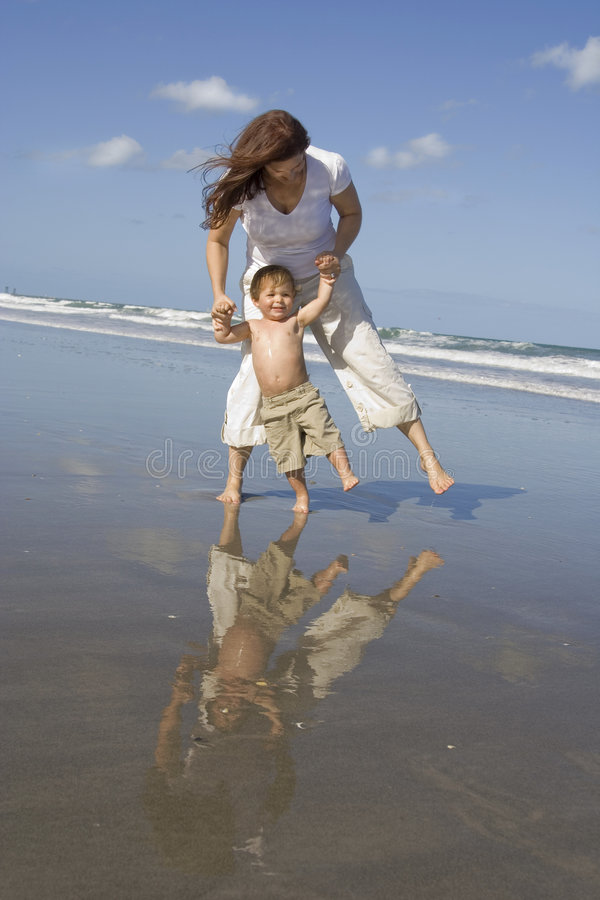 Mom and son on a beach stock photos