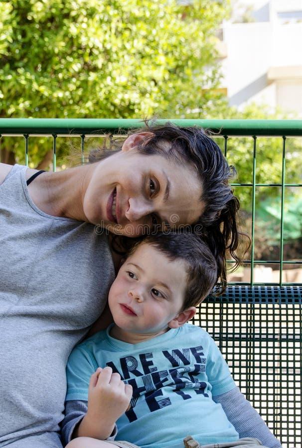 Mom and son bonding stock photos