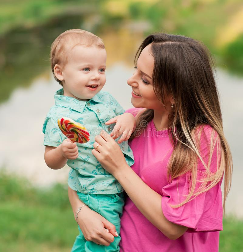 Mom and son with a child in summer park stock photo