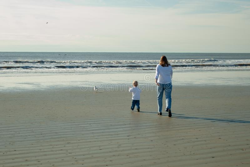 Mom and Son heading towards ocean royalty free stock images