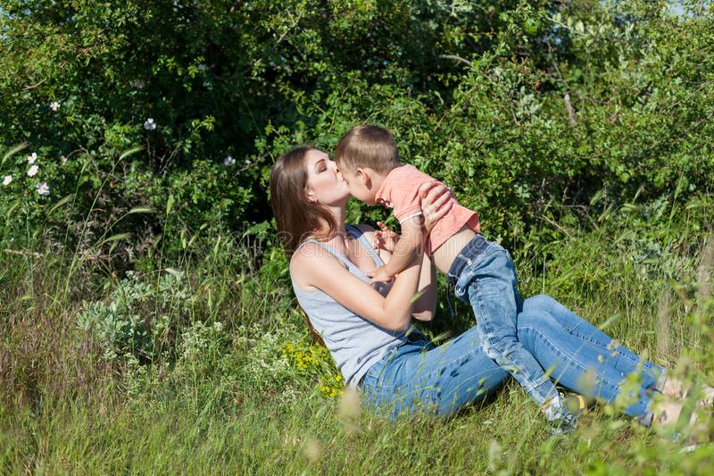 Mom and son on a picnic in the woods in nature royalty free stock image