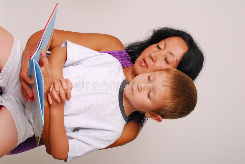 Mom & Son Reading One royalty free stock images