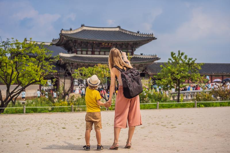 Mom and son tourists in Korea. Gyeongbokgung Palace grounds in Seoul, South Korea. Travel to Korea concept. Traveling royalty free stock image