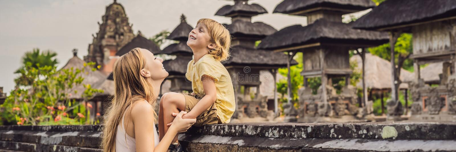 Mom and son tourists in Traditional balinese hindu Temple Taman Ayun in Mengwi. Bali, Indonesia Traveling with children concept BA. Mom and son tourists in royalty free stock photography
