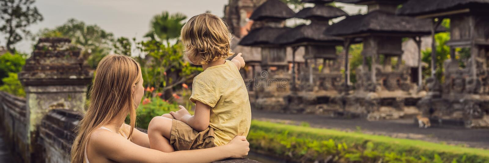Mom and son tourists in Traditional balinese hindu Temple Taman Ayun in Mengwi. Bali, Indonesia Traveling with children concept BA. Mom and son tourists in stock image