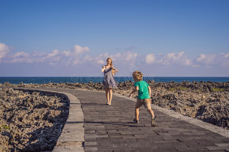 Mom and son travelers on amazing Nusadua, Waterbloom Fountain, Bali Island Indonesia. Traveling with kids concept.  stock photos