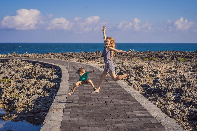 Mom and son travelers on amazing Nusadua, Waterbloom Fountain, Bali Island Indonesia. Traveling with kids concept.  royalty free stock images