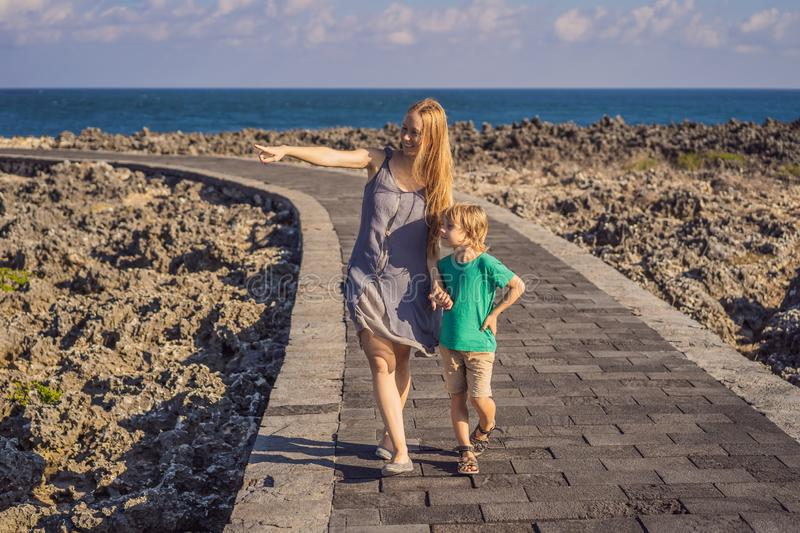 Mom and son travelers on amazing Nusadua, Waterbloom Fountain, Bali Island Indonesia. Traveling with kids concept.  royalty free stock photography