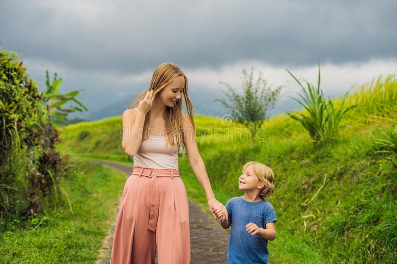 Mom and son travelers on Beautiful Jatiluwih Rice Terraces against the background of famous volcanoes in Bali, Indonesia royalty free stock photos