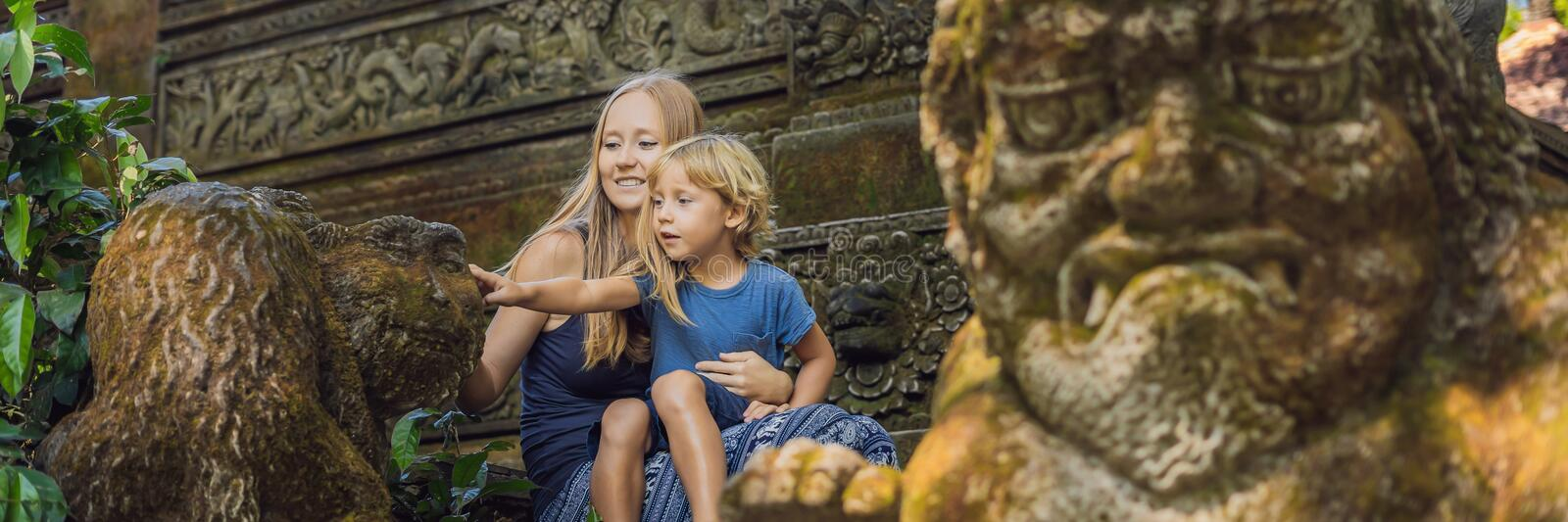 Mom and son travelers discovering Ubud forest in Monkey forest, Bali Indonesia. Traveling with children concept BANNER, long forma stock photo
