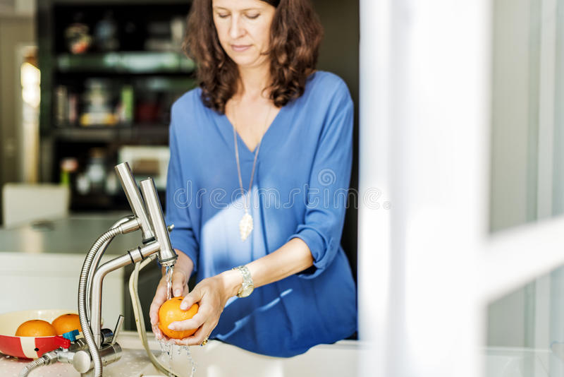 Mom Son Washing Fruits Togetherness Cheerful Concept royalty free stock photos