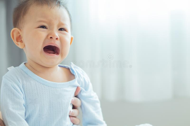 Mom soothes baby. The baby is crying royalty free stock photos