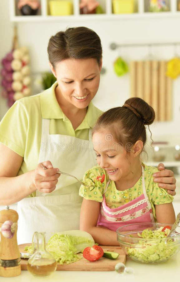 Mom teaches daughter to cook royalty free stock image