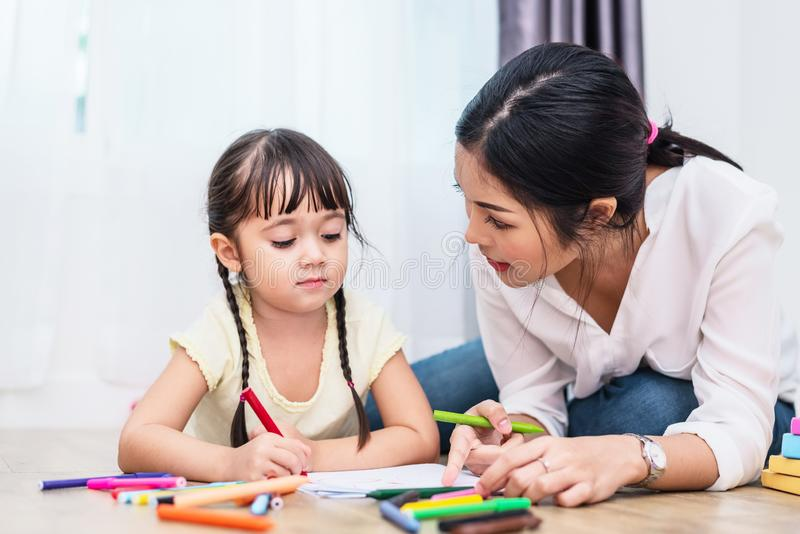 Mom teaching her daughter to drawing in art class. Back to school and Education concept. Children and kids theme. Home sweet home stock photos