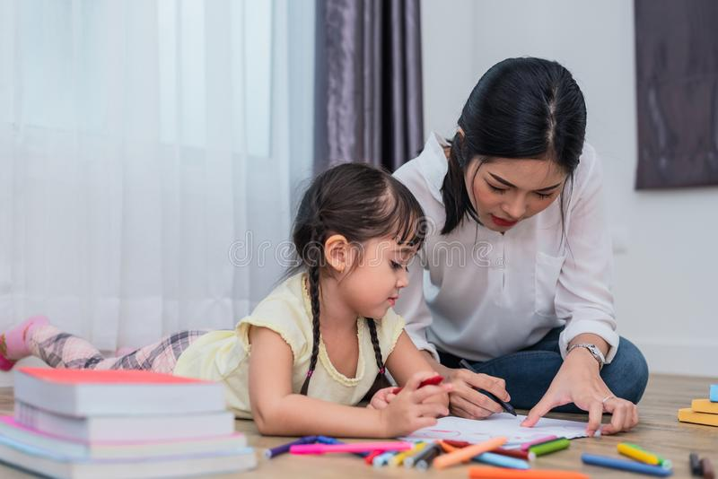 Mom teaching her daughter to drawing in art class. Back to school and Education concept. Children and kids theme. Home sweet home stock images