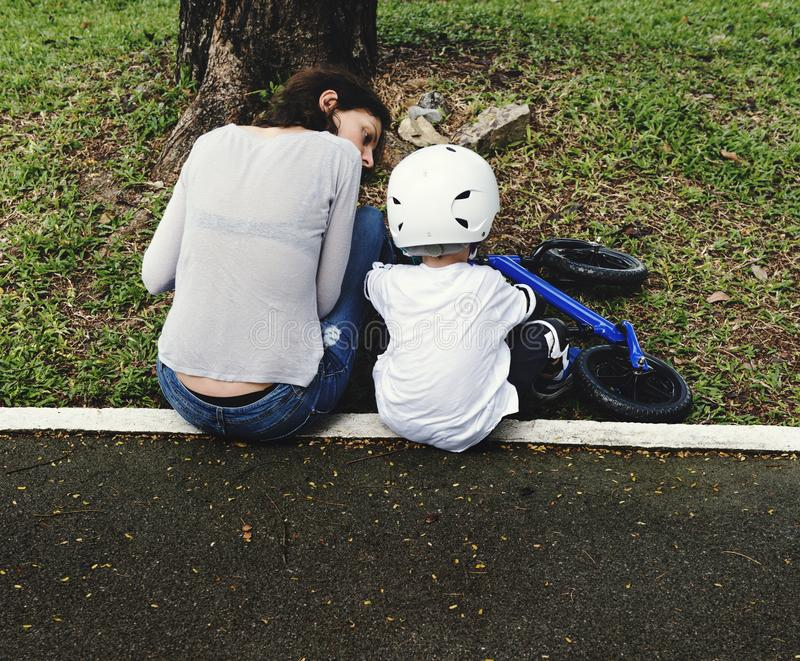 Mom Teaching Son Biking at Park Outdoors stock photo