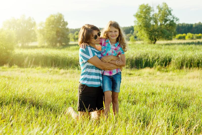 Mom with tenderness and love hugs her daughter. stock photos