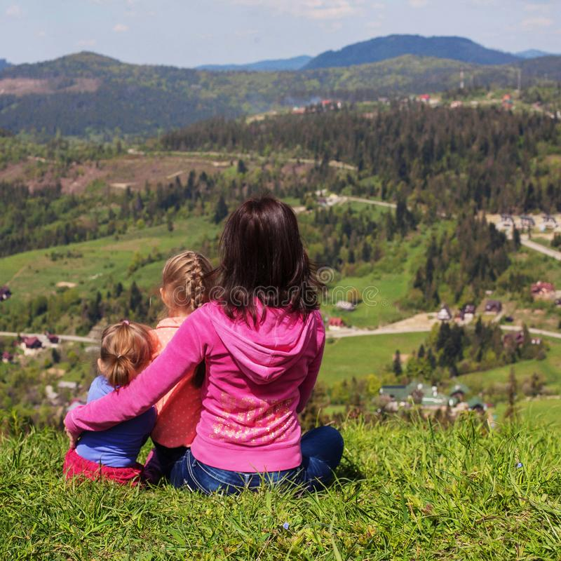 Mom and two children in the mountains. Square. The concept of fa. Mily, yoga, travel stock photo