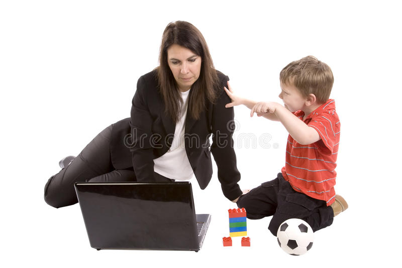 Mom Working Son Playing Stock Image