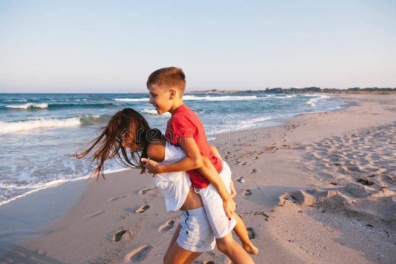 Mom and son walking and playing on the beach stock photography