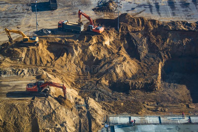 The moment of construction, digging of a ditch with excavators, foundation laying. stock image