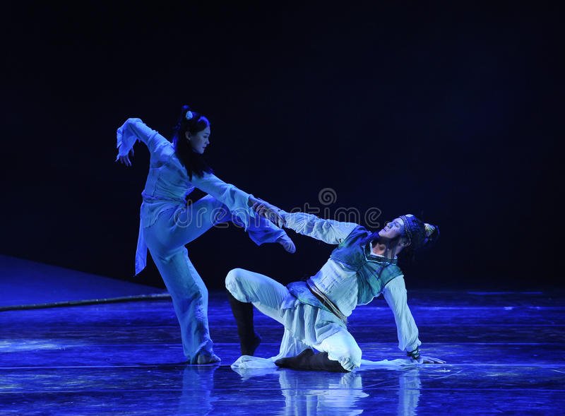 In a moment of desperation -The dance drama The legend of the Condor Heroes. In December 2, 2014, a large Chinese dance drama the legend of the Condor Heroes for royalty free stock photo
