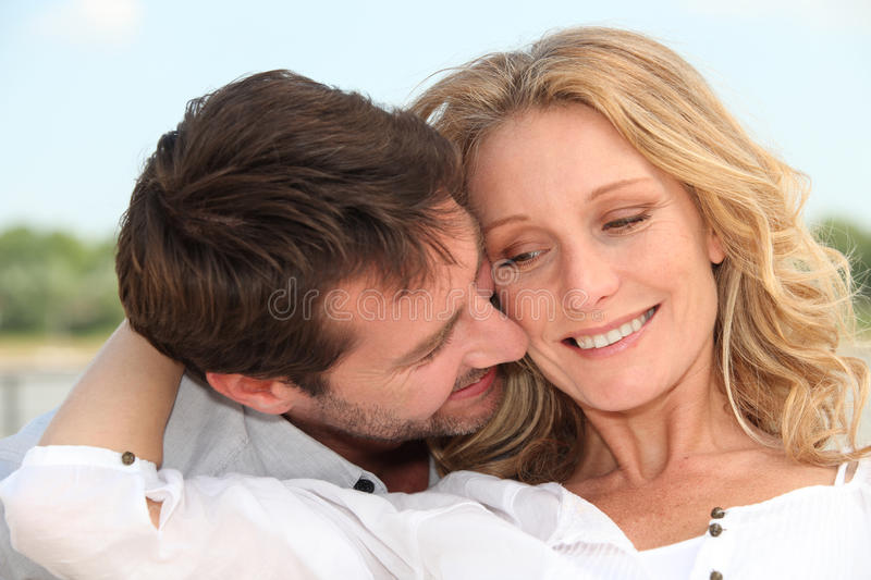 A moment of tenderness. Between men and woman stock image