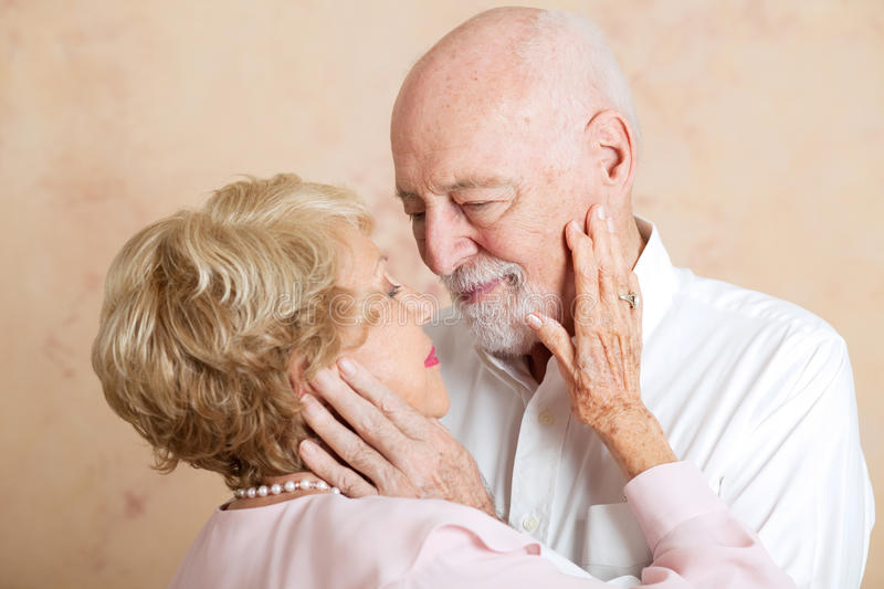 Moment of Tenderness - Senior Couple stock photo