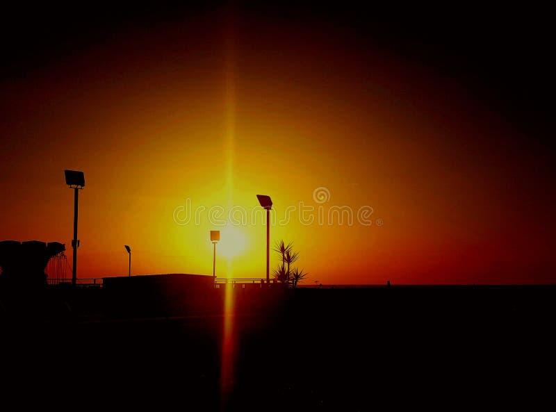 Momento do por do sol foto de stock royalty free