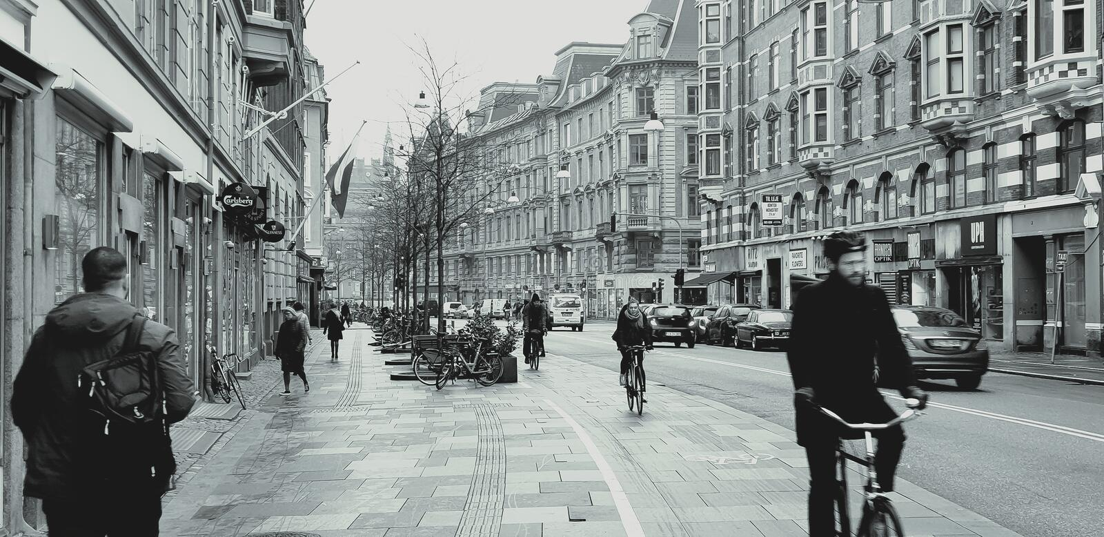 The moments of the Danish capital. Broad street in the center of Copenhagen`s capital. The bike has a large, wide band that we see as safe. Different cyclist royalty free stock image