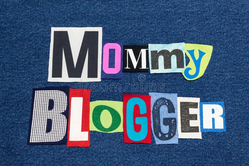MOMMY BLOGGER text word collage colorful fabric on blue denim, parenting blogs and blogging stock photo