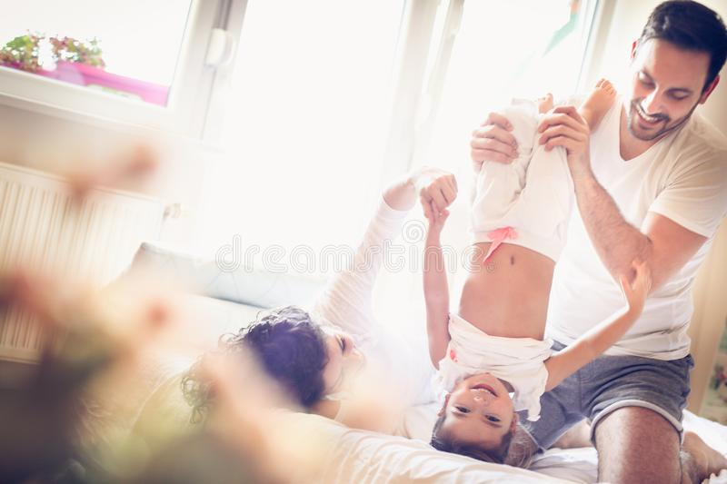 Mommy and daddy make me laugh every morning. stock images
