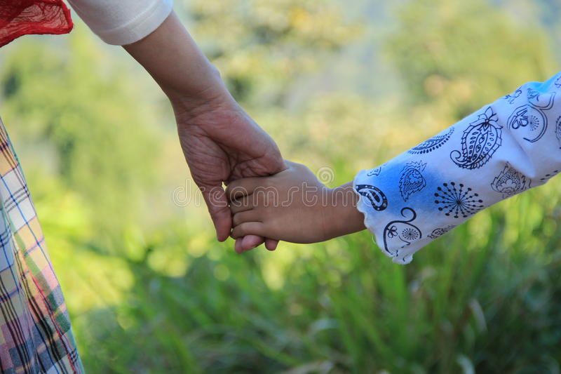Mommy holds my hand stock photo