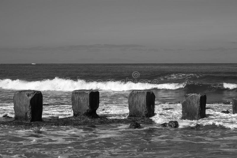 Momochrome sea defence on Moray Firth Scotland royalty free stock images